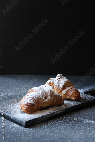 Fotografija Croissant on a black background