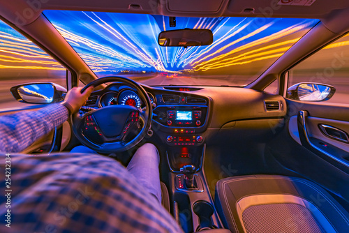 driving a car at night at high speed view from the car Canvas Print