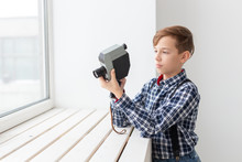 Photographer, Children And Hobby Concept - Cute Teen Boy Posing With Retro Camera On White Background