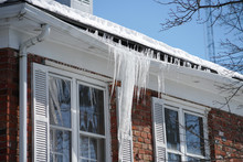 Icicle On The House Roof In Winter Season