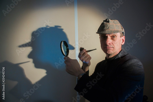 detective at work with magnifying glass and pipe investigating crimes Wallpaper Mural