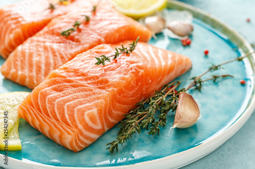 Photo Seafood. Fresh raw salmon or trout fillets with ingredients