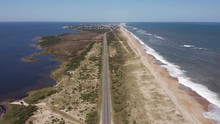 053 Aerial View Of Road Between Oceanside And Soundside. 4k
