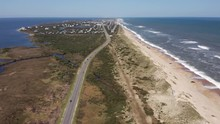 057 Aerial View Of Road Between Oceanside And Soundside. 4k