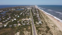 060 Aerial View Of Road Between Oceanside And Soundside. 4k