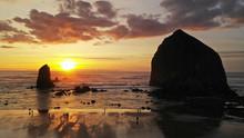 Dramatic Orange Light At Sunset On Pacific Coast At Cannon Beach