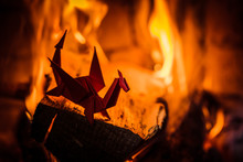 Origami Paper Toy Dragon On The Background Of Burning Fire