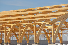 Construction Of Laminated Veneer Lumber. Construction Of A New Building With The Reception Of New Technologies. The Use Of Laminated Wood Saves Resources.