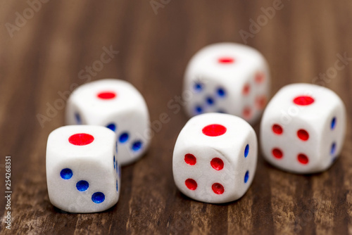 Fotografia, Obraz  Five white dice shows the number 1 on a wooden table