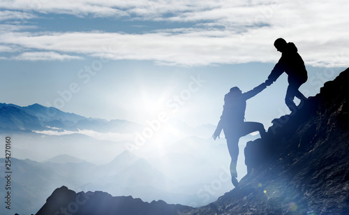 Mountaineers help each other to reach the summit Canvas