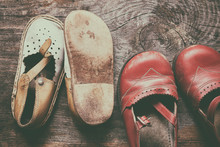 Children Vintage Shoes On Old Wood Background. Childhood Memory