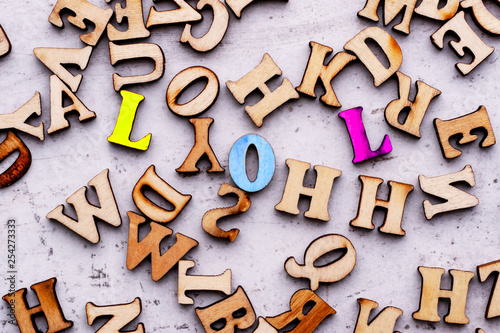Fototapety, obrazy: Inscription LOL LAUGHING OUT LOUD abbreviation in wooden letters on a light background