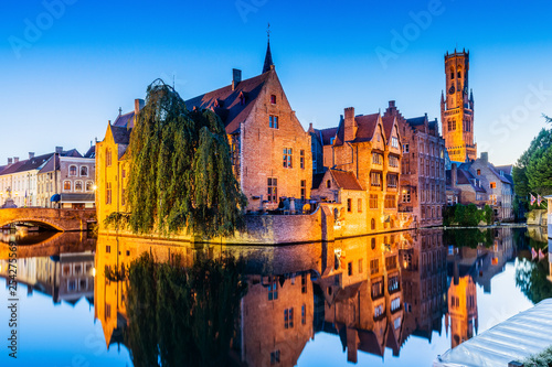 Wall Murals Bridges Bruges, Belgium. The Rozenhoedkaai canal in Bruges with the Belfry in the background.