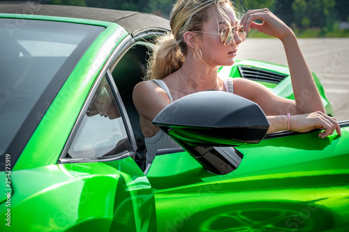 woman in sports car Wallpaper Mural