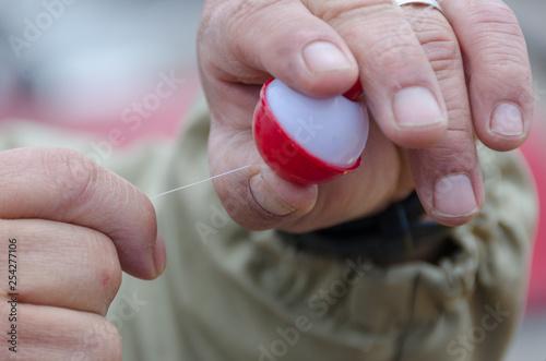 Fotografie, Obraz  Tying Off Fishing Bobber