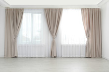 Windows With Elegant Curtains In Empty Room