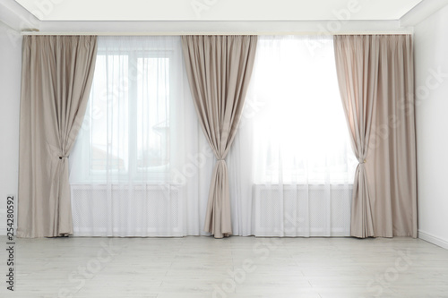 Fotomural Windows with elegant curtains in empty room