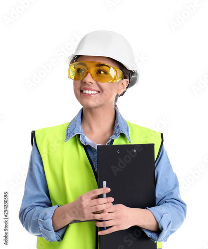 Fotografía  Female industrial engineer in uniform with clipboard on white background