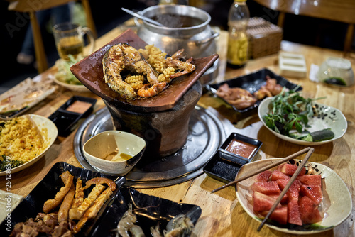 Fotografie, Obraz  Traditional vietnamese hot spot restaurant with varied food