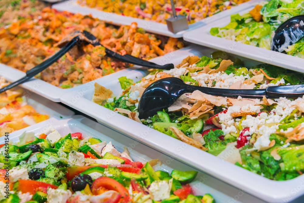 Fototapeta Assortment of fresh vegetable salads in restaurant buffet