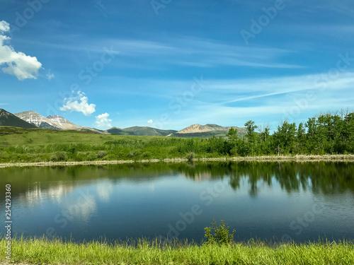 Fototapeta landscape with lake and blue sky obraz na płótnie