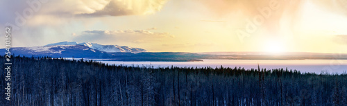 Printed kitchen splashbacks Beige Panoramic frozen winter landscape view of Yellowstone National Park with sunlight shining in the background of the snowy mountain range