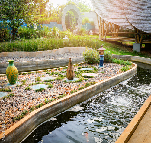 Fotografie, Obraz  Beautiful Water pond in the garden classic round design for fish pond