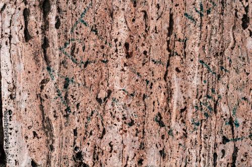tło brązowy teksturowanej porowatego warstwowego granitu z bliska