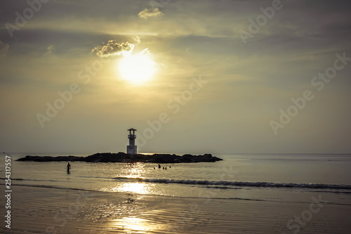Vászonkép  Image of small lighthouse against a tropical ocean sunset and smooth water at Khao Lak Beach in Phang Nga,Thailand