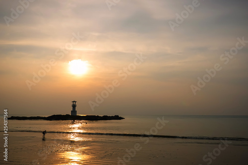 Fényképezés  Image of small lighthouse against a tropical ocean sunset and smooth water at Khao Lak Beach in Phang Nga,Thailand