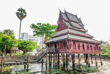 Ancient Wooden Monastery And The Library On Stilts In Wat Thung Si Muang Temple In Ubon Ratchathani In Isan, North Eastern Thailand..