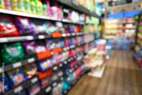 Fotografiet  goods shelf in business supermarket, image blur background