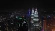 night time illuminated kuala lumpur downtown cityscape aerial panorama 4k malaysia
