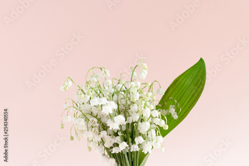 Poster Lelietje van dalen Bouquet of lilies of the valley with green leaves