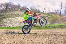Biker On Motorcycle Stunts Whi...