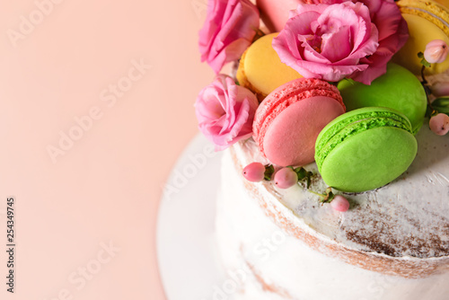 Sweet cake with floral decor on color background, closeup