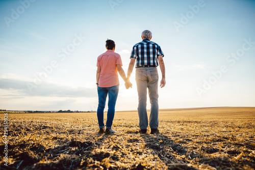 Fotografie, Obraz  Couple of senior woman and man having an evening stroll