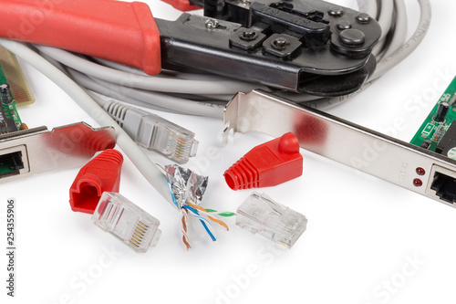 Fotografía  Twisted pair cable and connectors against network components, crimping tool