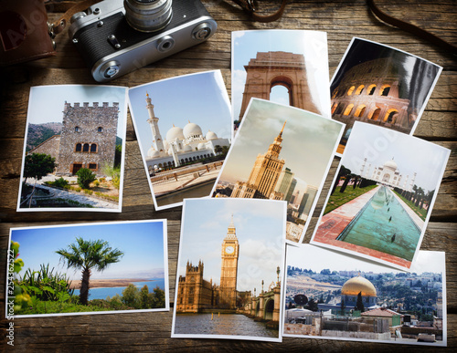 Old retro pictures and camera on wooden table globetrotter photography travel collage concept Wall mural