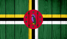 Flag Of Dominica On Wooden Background