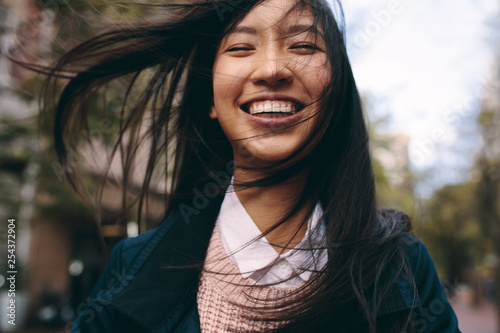 Fototapeta Close up of a smiling asian woman obraz