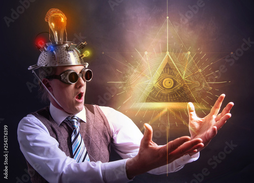 Slika na platnu distraught looking conspiracy believer in suit with aluminum foil head and illum