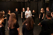 Leinwandbild Motiv Teacher With Male And Female Drama Students At Performing Arts School In Studio Improvisation Class