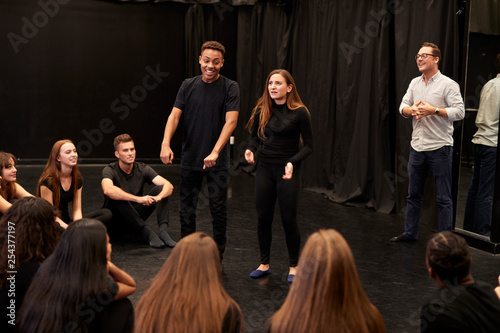 Fotografie, Obraz  Teacher With Male And Female Drama Students At Performing Arts School In Studio