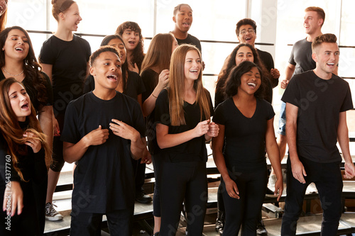 Fényképezés Male And Female Students Singing In Choir At Performing Arts School