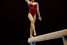 Woman Gymnast Preparing On Exercise Balance Beam In Gymnastics