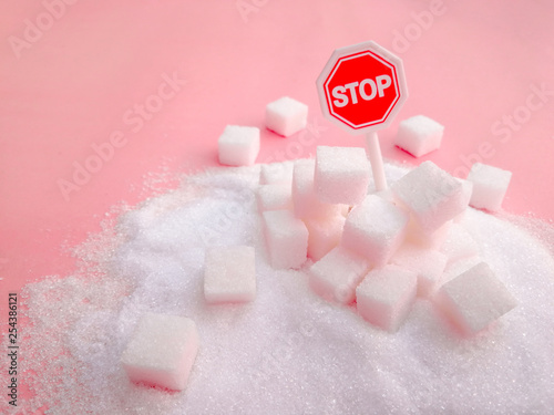 Fotografia, Obraz Stop sign on the sugar, warned that the sugar too much will make unhealthy nutrition, obesity, diabetes, dental care and much more