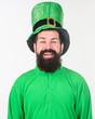 Leinwanddruck Bild - Irish eyes are smiling. Irish man with beard wearing green. Bearded man celebrating saint patricks day. Hipster in leprechaun hat and costume. Happy saint patricks day
