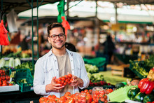 Young Man At Farmer's Market W...