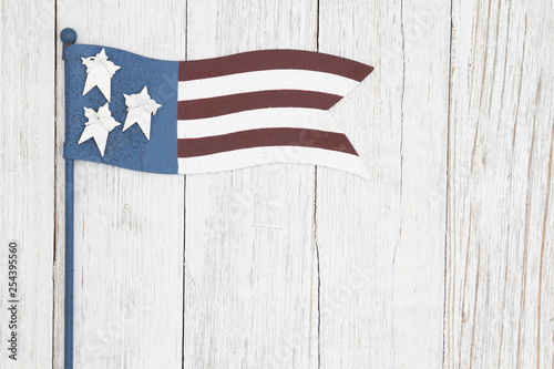 Red, white and blue retro American flag on weathered whitewash textured wood background